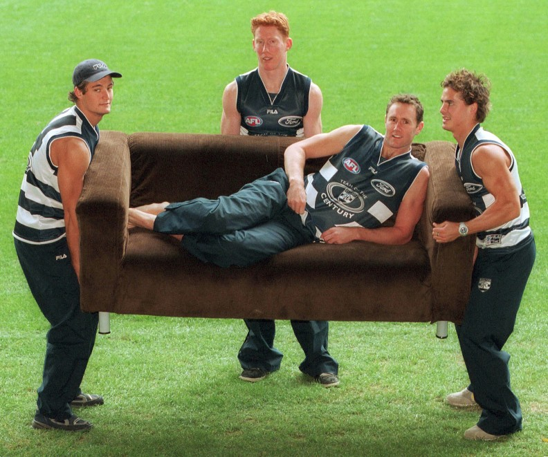 07/06/2001. .James Rahilly, left, Cameron Ling and Davis Spriggs give their captain Ben Graham (on couch) a boost. Geelong Football Team. Team of the Century nominations.